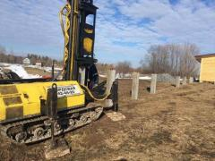 Driving of reinforced concrete piles.Piles. Foundation.Screw piles